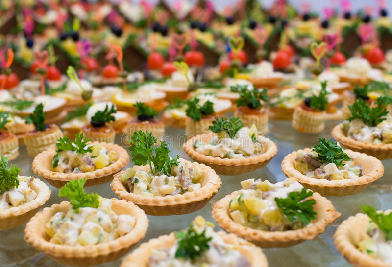 Buffet table salad in tartlets royalty free stock images