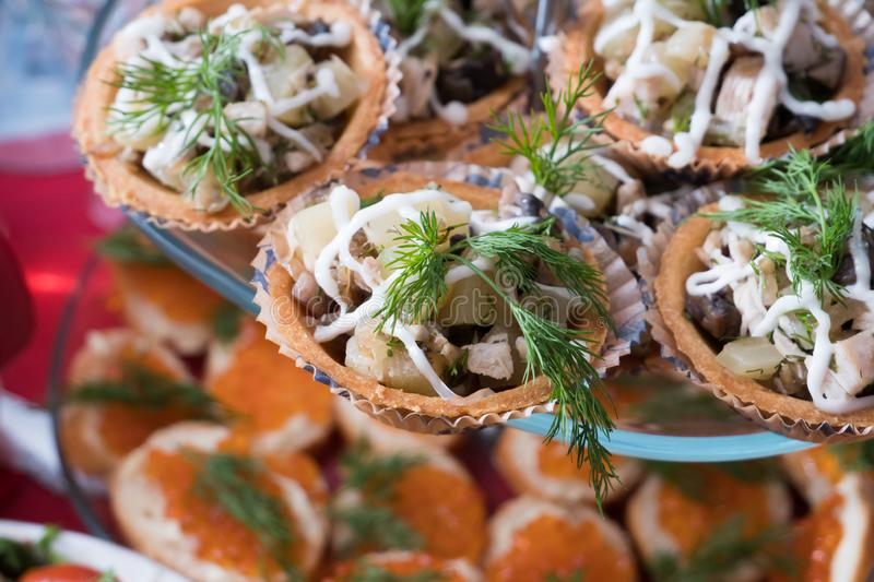 Chicken, mushroom and pineapple salad with mayonnaise in tartlet royalty free stock images