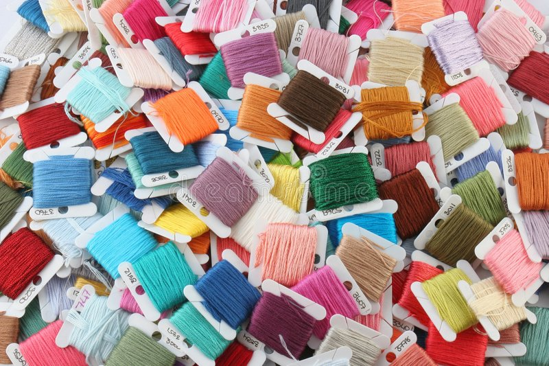 Colorful Embroidery Thread. Randomly colored and stacked pile of Embroidery thread cards. Standard colour numbers showing on some cards stock photo