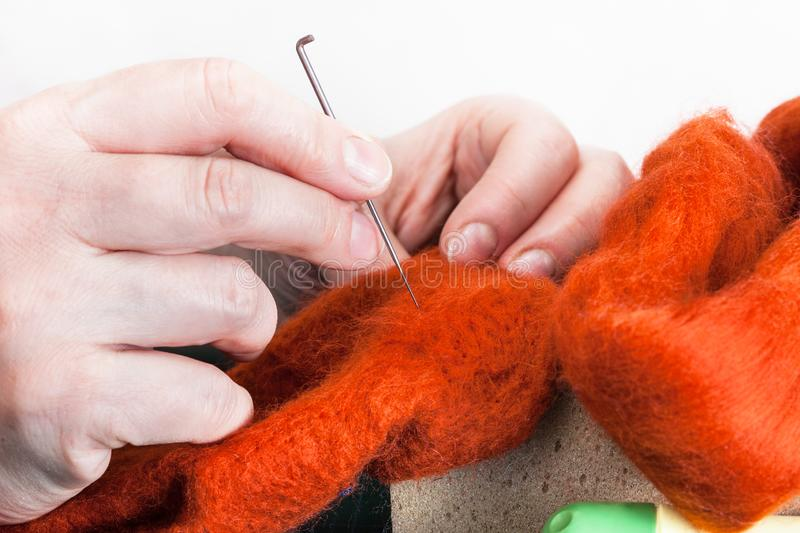 Craftsman mending felted cloth with felting needle royalty free stock photos