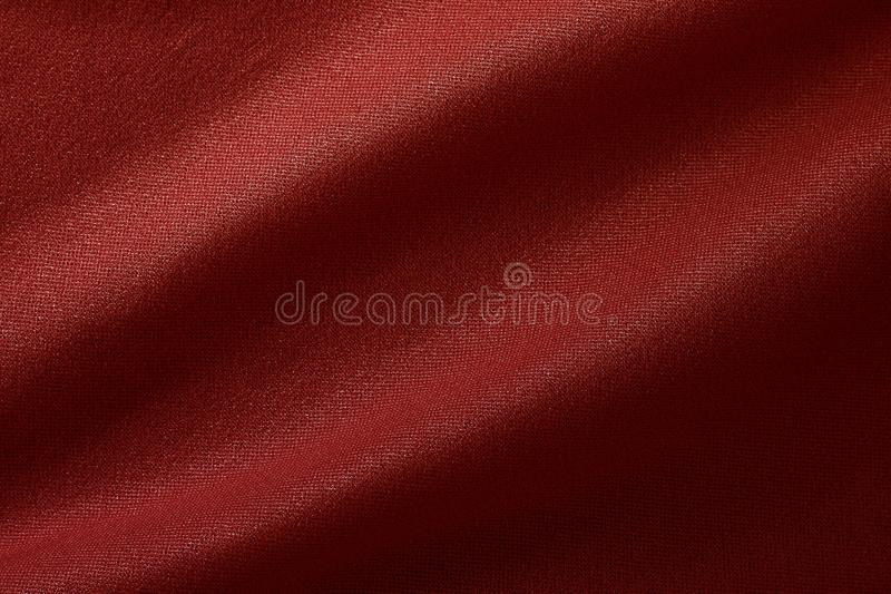 Dark red fabric cloth texture for background and design art work, beautiful crumpled pattern of silk or linen stock photo
