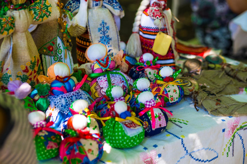 Doll is made of fabric. Sewn doll in a traditional costume, handmade. Doll motanka. Russian tradition the hand-made stock image