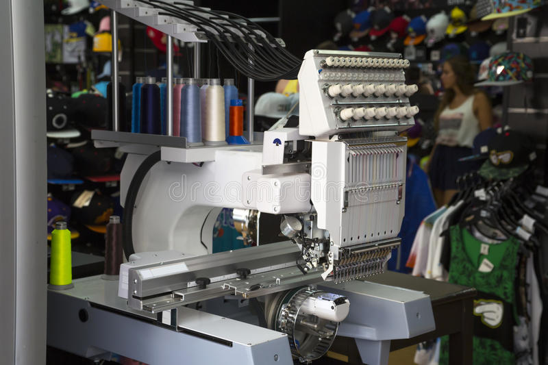Embroidery machine. With spools of color threads stock image