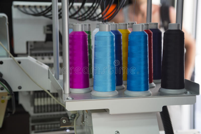 Embroidery machine. With spools of color threads royalty free stock image