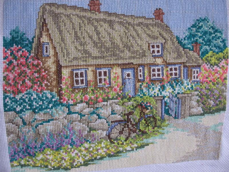 Embroidery. Needlework stitching house parterre stock images