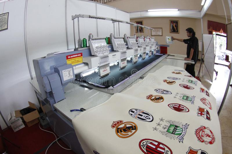 Embroidery. Operator was operating embroidery machine in the city of Solo, Central Java, Indonesia royalty free stock image
