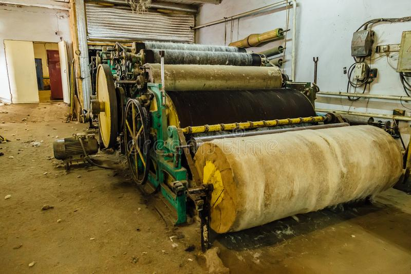 Felt boot production line. Wool processing machine. Carding of wool equipment stock photo
