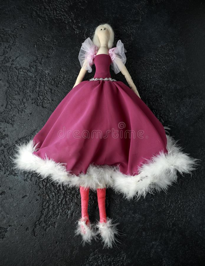 Handmade doll tilda in beautiful dress with white hair royalty free stock images