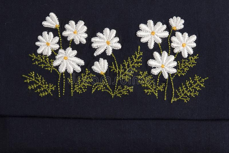 Handmade embroidery. Hobby work folkloric flowers royalty free stock image