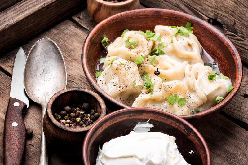 Homemade meat dumplings. Traditional dish pelmeni.Meat dumplings on wooden rustic background.Russian food stock photos
