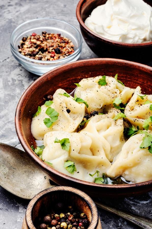 Homemade meat dumplings. Traditional Russian dish pelmeni.Meat dumplings on rustic background stock photo