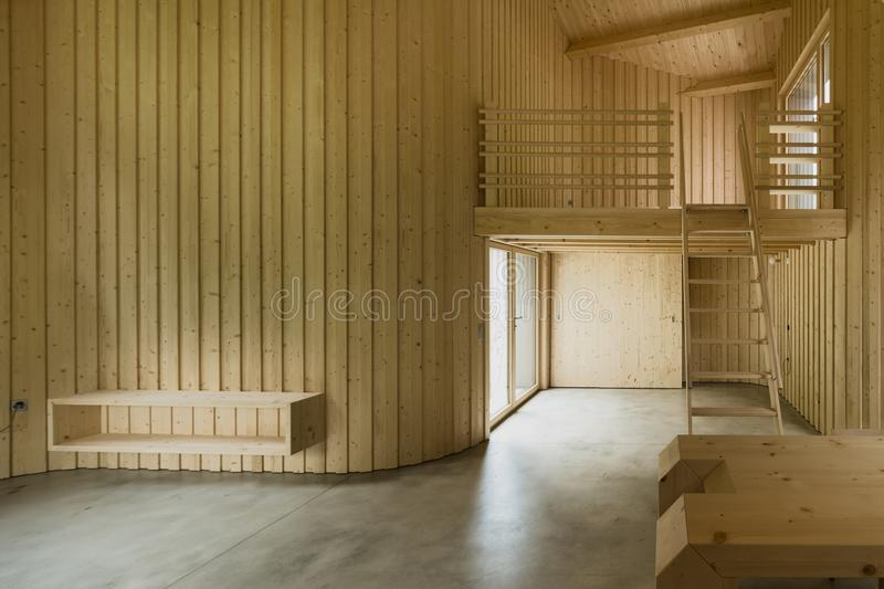 Interior of modern wooden house. Modern house, wooden interiors open space stock image