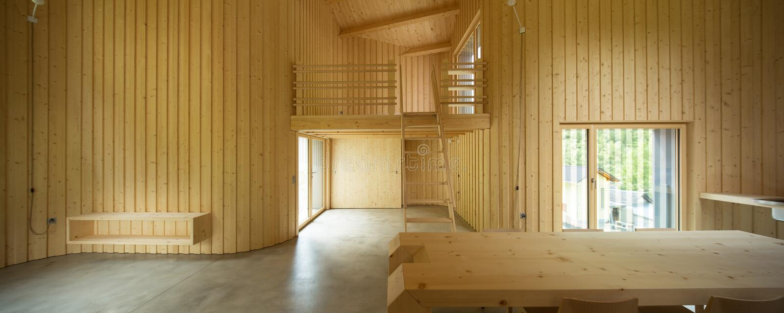Interior of modern wooden house. Modern house, wooden interiors open space. Project by Daniel Buren and Davide Macullo stock photography