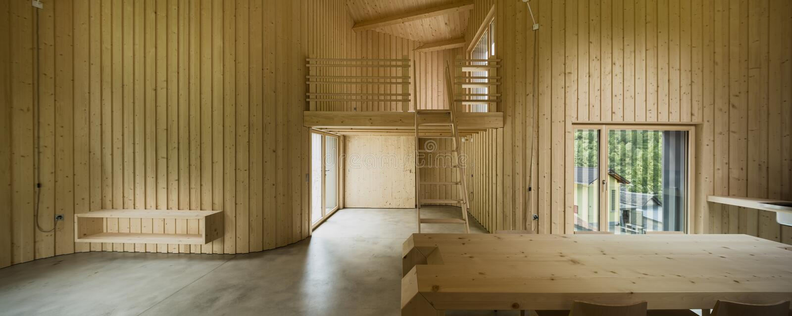 Interior of modern wooden house. Modern house, wooden interiors open space. Project by Daniel Buren and Davide Macullo stock photos