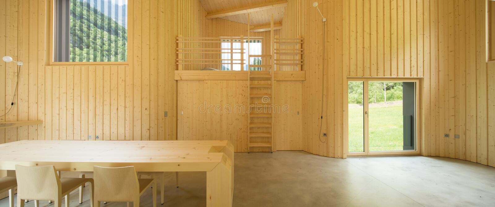 Interior of modrn wooden house. Modern house, wooden interiors open space royalty free stock photography