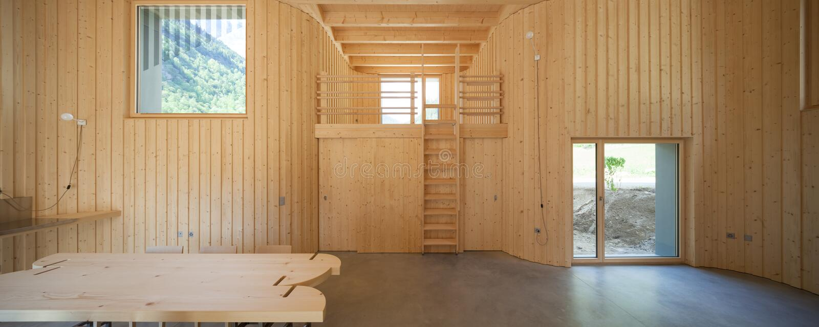 Interior of modrn wooden house. Modern house, wooden interiors open space. Project by Daniel Buren and Davide Macullo royalty free stock photo