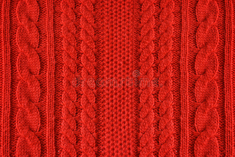 Knitted woolen background, red texture royalty free stock images