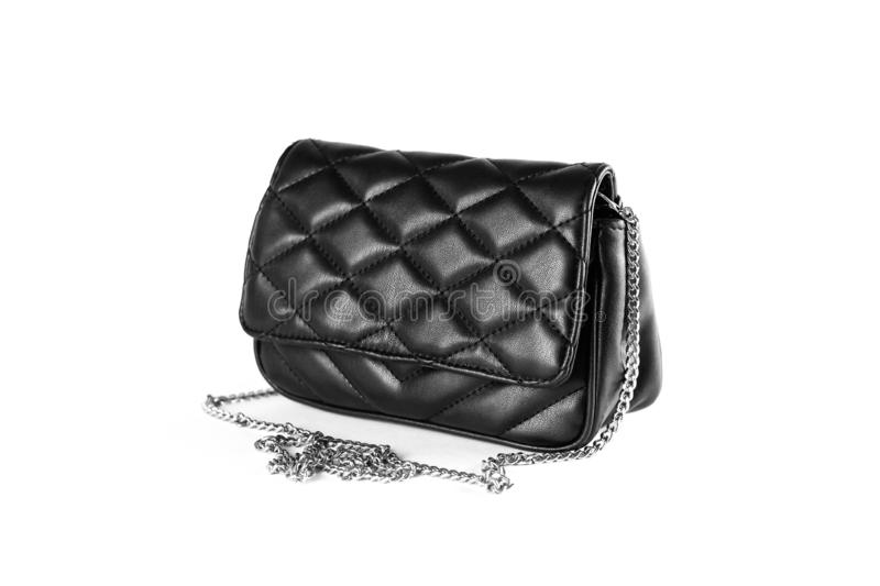 A little black leather woman`s handbag. Clutch. Close up. Isolat royalty free stock photography