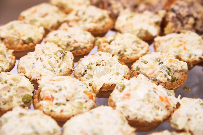 Many tartlets with russian salad on buffet table royalty free stock photography