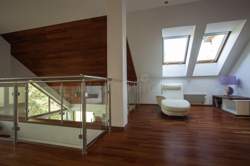 Mezzanine in a modern house. Mezzanine with wooden floor and white walls royalty free stock photography