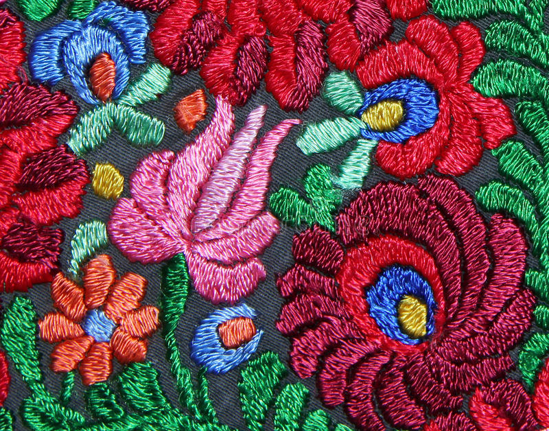 Multicolor floral hand embroidery pattern. Background royalty free stock image