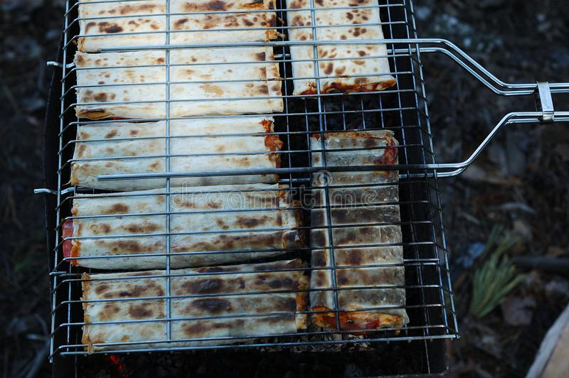 Preparation of stuffed pita on the grill royalty free stock photo