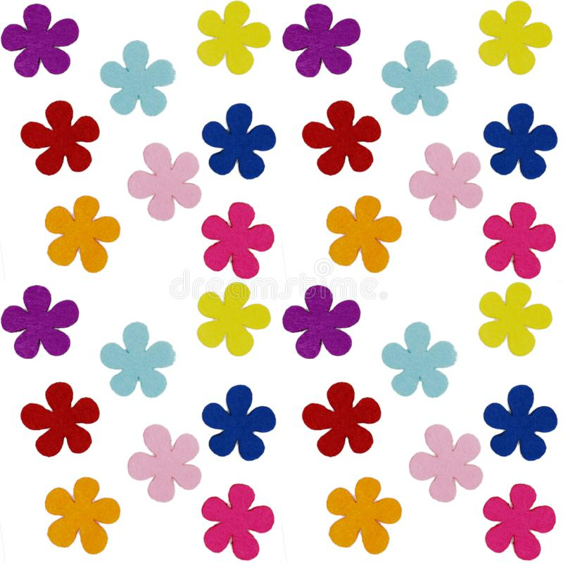 Seamless pattern of colored felt flowers on a white background royalty free stock image