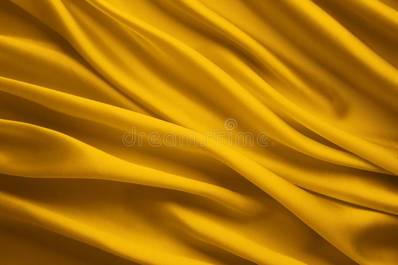 Silk Fabric Background, Yellow Satin Cloth Waves Sheets stock photo
