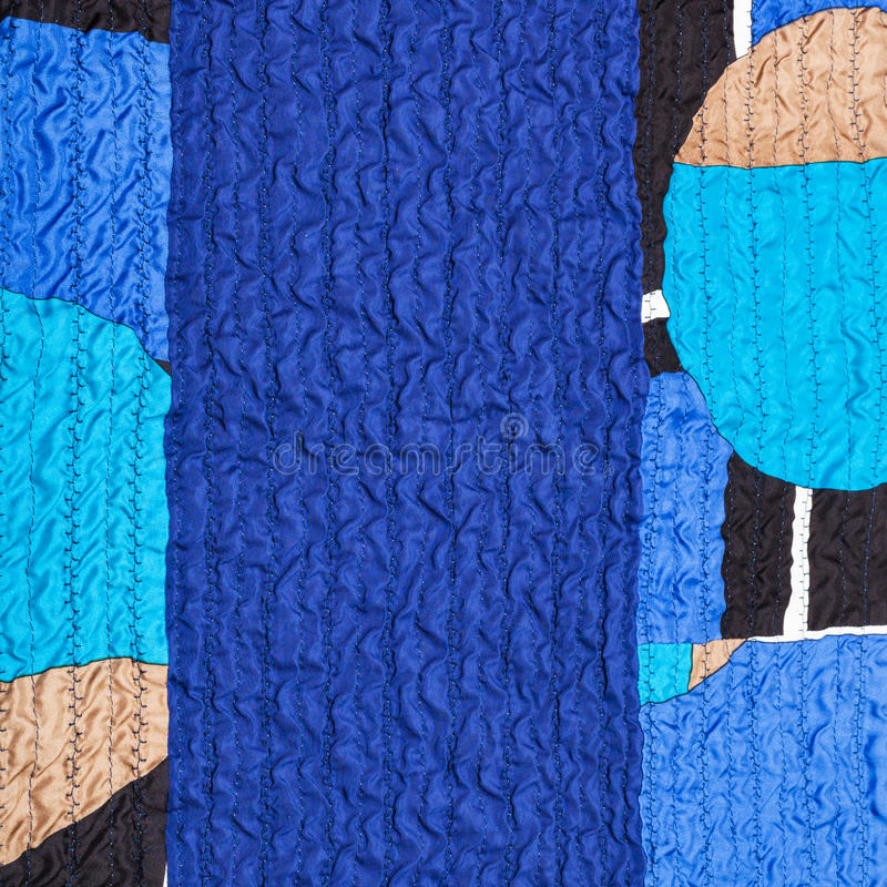 Stitched wrinkled blue silk fabric and patchwork stock images