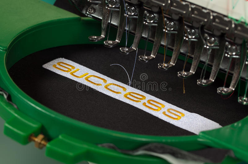Success embroidery. Textile embroidery machine in Textile Industry stock photos