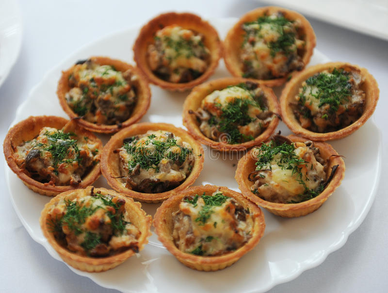 Tartlets with chicken salad and herbs stock photography