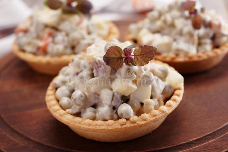 Tartlets with Russian salad stock photography