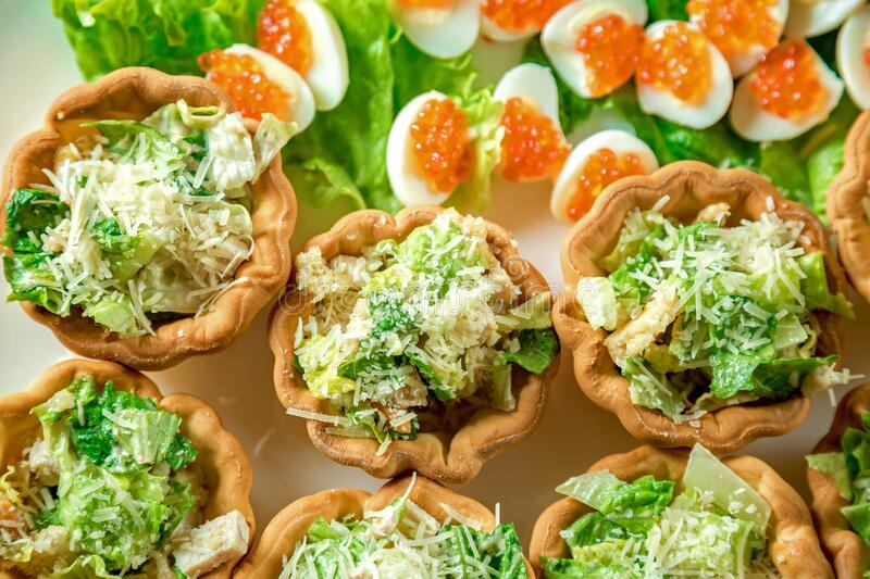 Tartlets with salad caviar and eggs on a plate royalty free stock photography