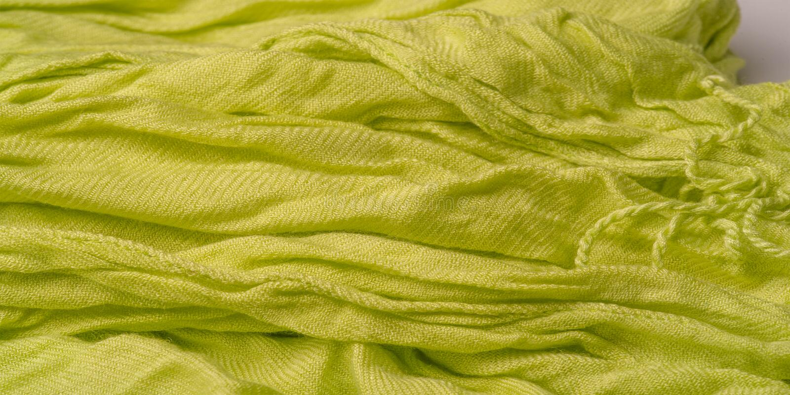 Texture, background, pattern, postcard, silk fabric, light green color, aureolin, artificially wrinkled fabric, wrinkled texture,. Texture background pattern royalty free stock photo