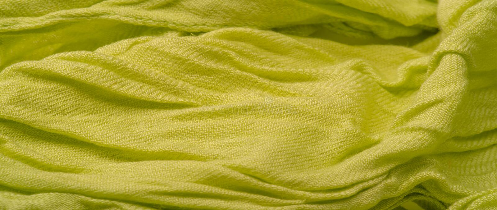Texture, background, pattern, postcard, silk fabric, light green color, aureolin, artificially wrinkled fabric, wrinkled texture,. Texture background pattern stock images