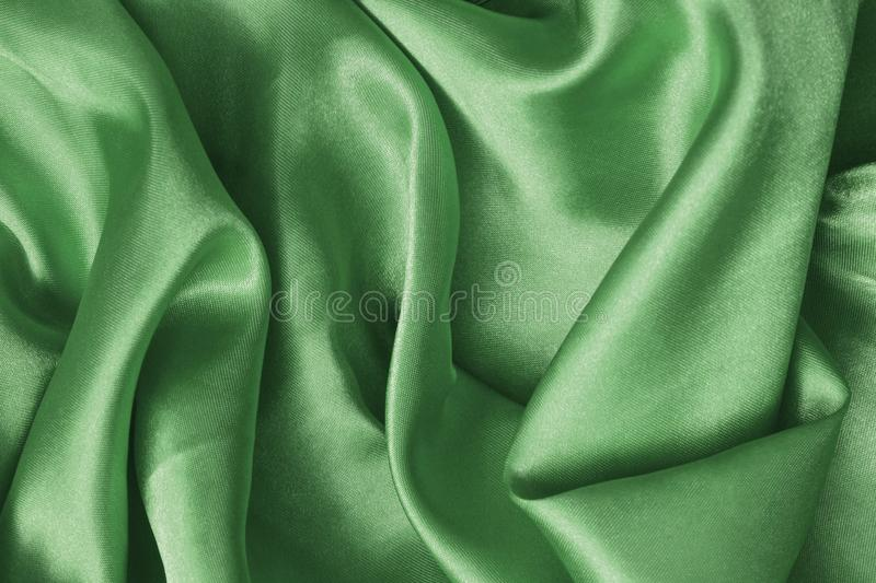 Texture green satin, silk background royalty free stock photography