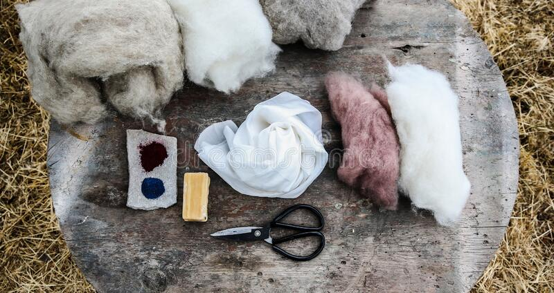 Wet felting wool and silk, scissors soap and natural dyes royalty free stock images