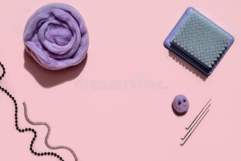 wool for felting. Flat lay. lilac wool for the creative craft fashion work.billet head for toys.needles royalty free stock image