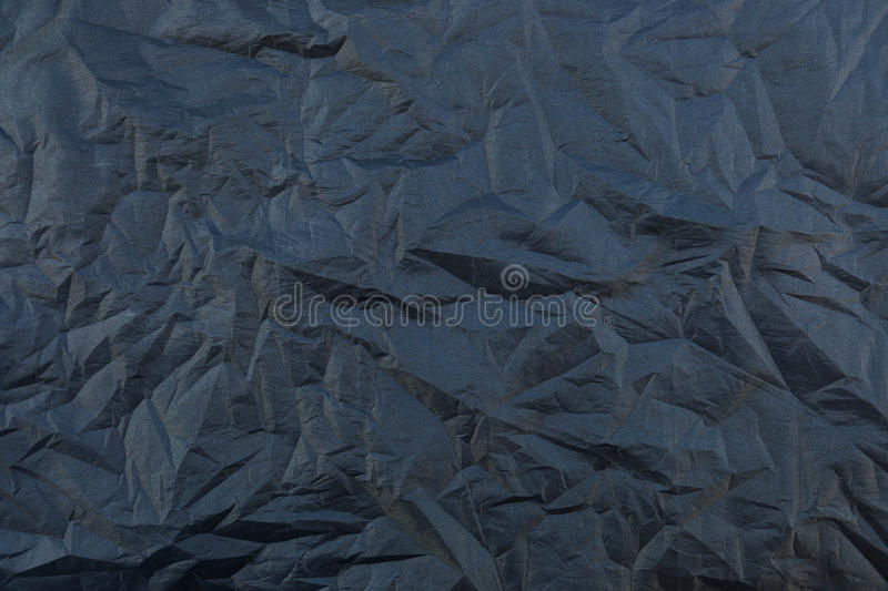 wrinkled black silk fabric texture for background and design royalty free stock images