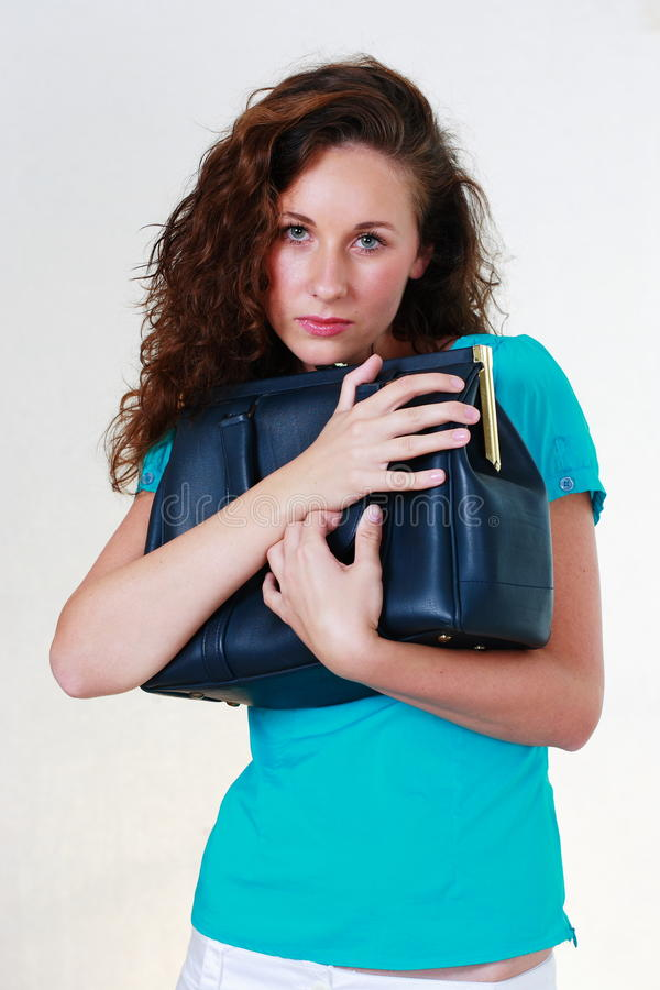Young woman with handbag stock photos